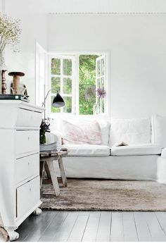 Shabby living room with white sofa