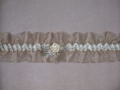 Beautiful garter in gold transparent ribbon . Designed and hand made by  www.alterationsavenue.com