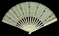 Fan Date: 1900–1915 Culture: French Medium: Ivory, metal, silk, sequins Credit Line: Brooklyn Museum Costume Collection at The Metropolitan Museum of Art, Gift of the Brooklyn Museum, 2009; Gift of Malvina Hoffman, 1960
