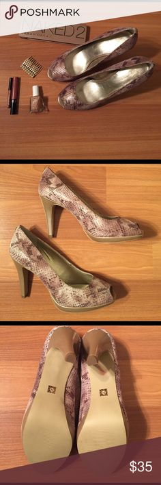 Anne Klein Dynah Metallic SnakeskinPeep Toe Pumps NWOT. Brand: Anne Klein. Style: Dynah. These peep toes are a fantastic going out shoe. Snakeskin pattern is pink, cream, taupe, and grey with metallic pattern overlay. Never worn. Brand new. Minor marks on right sole near heel from tag removal. Never worn so no actual wear anywhere on shoe. Beautiful shoe! Please let me know if you'd like an extra pic. Accessories not included. Please let me know if you have any questions. Thanks for looking…