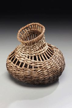 Sculptural Basket Artist creates one-of-a-kind ikebana baskets and ikebana containers from natural materials.