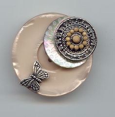 stunning button brooch