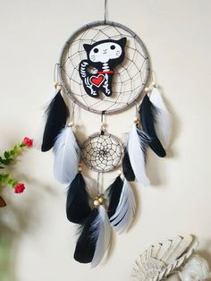 Kawaii Goth Skeleton Cat black and white Dream Catcher wall hanging, A one-of-a-kind, cool interpretation of the traditional dream catcher. The perfect gift to your favorite person and perfect wall decoration to complement a bedroom, dorm room or nursery. Handcrafted with positive thoughts. Materials: ~ two metal rings, gray jute cord ~ black nylon string, silver beads, natural color wooden beads ~ black and white goose feathers ~ embroidered Skeleton Cat Dream Catcher Decor, Black Dream Catcher, Kawaii Goth, Goose Feathers, Room Decor, Wall Decor, Favorite Person, Wooden Beads, Silver Beads