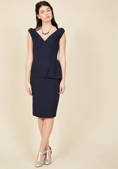 <p>The vintage-inspired detailing of this sultry, navy sheath dress will leave your amour totally breathless! Cap sleeves with subtle gathering at the shoulders frame the pleated bust of this pin-up-inspired ensemble, as its flared skirt embellishment rounds out a look of awe-inspiring proportion.</p>