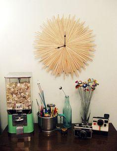 Starburst clock made out of wood coffee stir sticks.