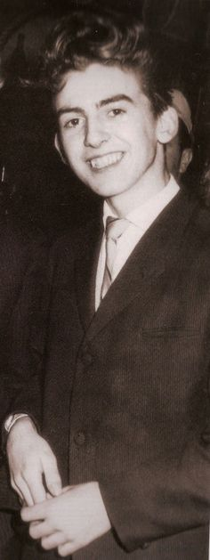 George Harrison in his youth.  George  was born in 1943 in Liverpool, England.   George's first wife was Patty Boyd whom he married in 1966 the marriage lasted until 1977. George Harrison died in 2001 at the age of 58 in Los Angeles, California.  George Harrison was one the unforgettable Beatles.