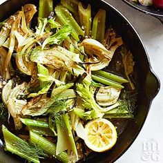 A fresh topping of green onion, celery leaves, and fennel fronds brightens up skillet caramelized veggies.