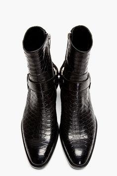 SAINT LAURENT Black Pythonskin Wyatt Harness Biker Boots. www.designerclothingfans.com