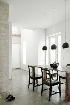 This kitchen is almost too white, but the long pendants are marvelous! Home decor, interior design, lighting