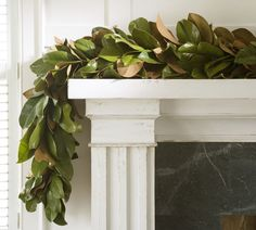 (no tutorial included.)   Garland, such as this one of live magnolia leaves, can add a touch of Southern flair to a fireplace mantel during the holidays.