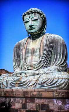 The Great Buddha statue in Kamakura, Japan,  A very beautiful and peaceful place .