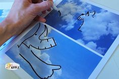 take pictures of clouds...printed and behind a plastic sheet...dry erase markers...quiet creative game to keep children busy!