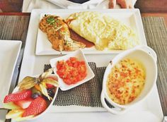 A meal of omelette, veggies, and fruit sits on a table at brunch spot Wildflower Grill in Edmonton. Brunch Spots, Omelette, A Table, Grilling, Veggies, Restaurant, Meals, Fruit, Breakfast