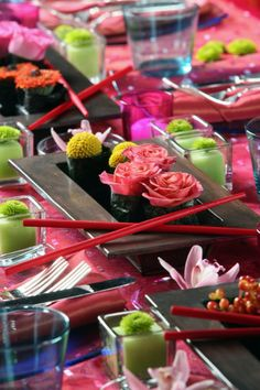 colorful, oriental-inspired tablescape with sushi, chopsticks, and florals - for my next sake & sushi party