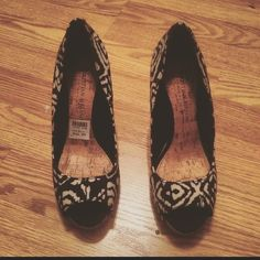 """NWOT Christian Siriano heels These were worn one time for a 2 hour event and are in perfect shape! I absolutely love them but have no use for them! :( the print is black and white. Originally bought from Payless for $35 plus tax. The heel measures close to 4"""" and is a cork heel which adds some fun to the shoes! Please feel free to ask any additional questions! NO TRADES  Christian Siriano Shoes Heels"""