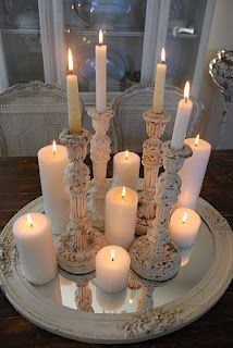 Candles ON TOP of mirrors are always a good combination.... gives a beautiful glow.