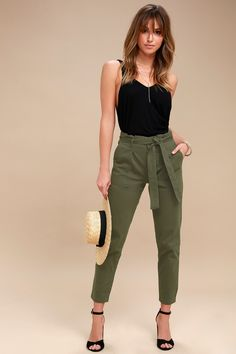 Your style game just got that much better thanks to the Leo Olive Green Tie-Waist Cropped Pants! Lightweight, stretch twill constructs these casual-chic pants that are perfect to take you from work to play. A high-waist, with sash tie allows a custom fit, while tapered legs and a cropped length creates a slimming-effect. Utility pockets finish the look. Hidden snap buttons and zip fly.