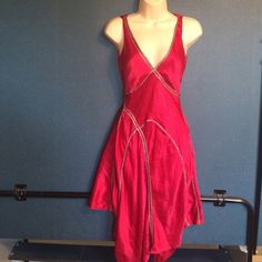 Language size 2 seductive red silk dress This is a super sexy red silk gold trim asymmetrical hem  sleeveless silk dress by language Sz 2 slips over your head no zippers bust measures 16 across lying flat pit  to pit 13 waist  19 hipthis was my Valentine's Day dress it was a showstopper💋 Language Dresses Asymmetrical
