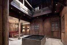 Boutique Hotel in 300 Year-Old Rural Building Wuyuan Skywells Hotel, Jiangxi, China By: Anyspace Architecture Design Adaptive Reuse, Wooden Stairs, Hotel Interiors, Restaurant Interiors, Commercial Architecture, Old Building, Dezeen, White Walls, Architecture Design