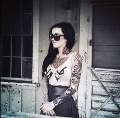 Awesome on so many levels.  I like the dagger tattoo and the one on her shoulder.  Also love her hair and clothes
