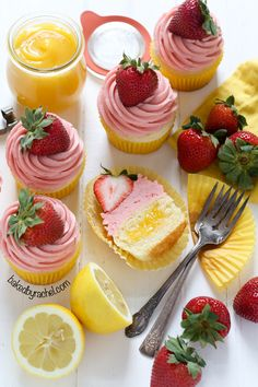 Moist strawberry lemonade cupcakes with lemon curd filling. Recipe from @bakedbyrachel