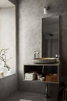 A beautiful concrete grey bathroom