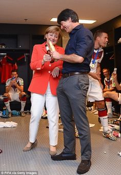 Angela Merkel celebrates with Head Coach Joachim Loew