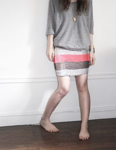 Sequins skirt with a basic jumper. Grey shiny sneakers will be perfect.