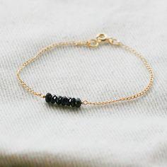 gold and black garnet bracelet
