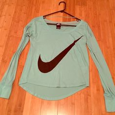 Nike long sleeve tee Light blue Nike shirt! Worn a few times but on great condition, no seen flaws. Size medium but I'm an xs/small and it fits me well. Nike Tops Tees - Long Sleeve
