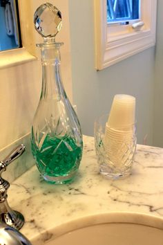 crystal decanter holds mouth wash in master bath via The Gracious Posse