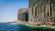 Staffa Island. Scotland. Pillar columns rock cliff sea.