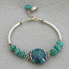 Sterling Silver noodle bracelet set with lampwork by ladylovesblue, $26.00