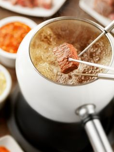 Host a German Meat and Broth Fondue Party With This Recipe - - Fleischfondue (or meat fondue) is a popular communal party meal in Germany, especially for New Year's Eve and the Christmas holidays. Fondue Recipe Melting Pot, Broth Fondue Recipes, Melting Pot Recipes, Jam Recipes, Sauce Recipes, Copycat Recipes, German Meat, Beer Cheese Fondue, Deserts