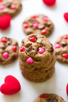 These Valentine's Day Gluten Free Chocolate Chip Cookies are easy and quick to make, dairy, gluten and grain free and loaded with sunflower butter and heart candies!