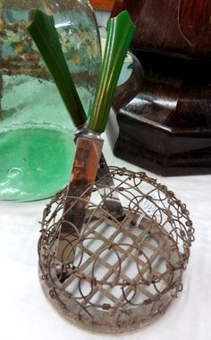 Round metal flower frog with adjustable wire dome.