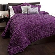 "Ruffled comforter set in purple.  Product: 1 Comforter, 2 pillow shams, and 2 decorative pillows Construction Material: PolyesterColor: PurpleFeatures: Inserts included with decorative pillowsDimensions: Standard Sham: 20"" x 26"" eachKing Sham: 20"" x 36"" eachNote: Inserts not included with shams. Queen option comes with standard shams, king option comes with king shams.Cleaning and Care: Dry clean"
