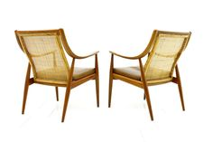 Early Pair of Hvidt and Molgaard Lounge Chairs, Teak and Cane, 1956 | From a unique collection of antique and modern lounge chairs at http://www.1stdibs.com/furniture/seating/lounge-chairs/