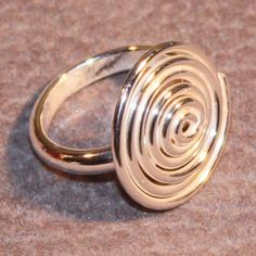 A personal favorite from my Etsy shop https://www.etsy.com/listing/120249385/swirl-ring