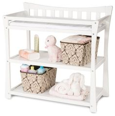 European style influences this contemporary chic option for baby's nursery Two extra shelves for storage Includes changing pad with security strap and buckle No