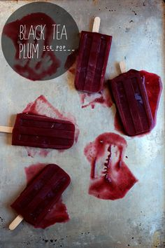 Black Tea Plum Ice Pops // I used a purple/red fleshed plum here, an amber fleshed plum will work just as well but may alter the finished color.   4 plums, quartered and pits discarded  2 cups brewed black tea  1/3 cup sugar plus 3 Tablespoons, divided    Preheat oven to 375*F.