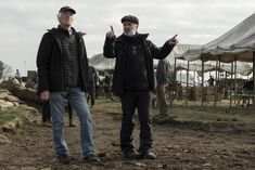 """Cinematographer Roger Deakins (left) and co-writer/co-producer/director Sam Mendes prepare for a scene on the set of """"1917"""", 2019.  Deakins and Mendes opened the movie with an unbroken 9 minute and 30 second shot and would continue the fluidity throughout the entire film. Roger Deakins, Sam Mendes, British Soldier, World War I, Good Movies, Writer, Mens Sunglasses, Film, Scene"""