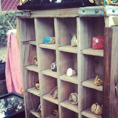 Great jewelry display idea, courtesy of Melrose Trading Post: a vintage soda crate placed on its side.