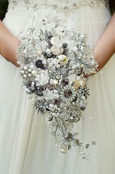 Cascading white and rhinestone brooch bouquet.