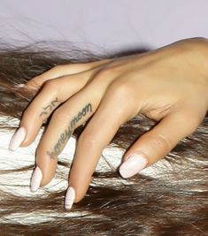 Ariana Grande Shows Off TWO New Finger Tattoos on Tour! http://www.popstartats.com/ariana-grande-tattoos/finger-honeymoon-hebrew/