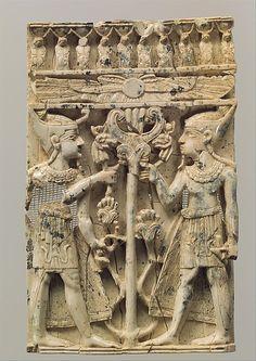 de-salva:    Plaque with pharaonic figures flanking a sacred tree (Ivory)  [Mesopotamia, Nimrud (ancient Kalhu), ca. 9th-8th century B.C.]