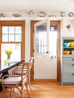 The new Dutch door and windows, whose simulated divided lights were made with lead tape, nod to original leaded-glass windows in the dining room. Home Design Decor, House Design, Home Decor, Kitchen Design, Kitchen Decor, Kitchen Ideas, Front Door Design, Interior Inspiration, Kitchen Inspiration