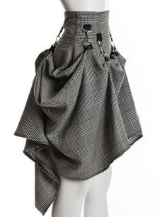 https://www.cityblis.com/7808/item/12625  SteamPunk Gray Black Victorian Skirt - $150 by PINaR ERIS  Steampunk couture by Pinar Eris is handcrafted focusing on Neo Victorian and shabby chic fashion. This easy to wear, gray and black neo Victorian steampunk skirt offers superb quality and cuts a striking look. Skirt is handmade from soft,100% Rayon with a black zipper and detailed with D rings and b...