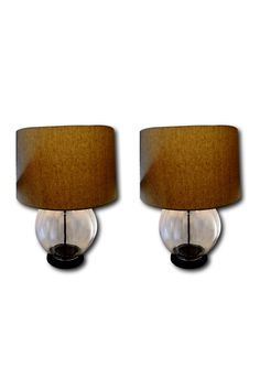 Set of 2 clear vintage Italian ribbed glass lamps that have been given a slight makeover with an oil rubbed bronze look to their neck, threaded pipe, base cap, and bottom. Contemporary look with the orb base and bulging glass against the dark hardware. Includes original wiring. Shade is NOT included, however I will be happy to provide you with a resource to purchase one. SHOP http://www.heathertique.com/products/a-set-of-two-2-vintage-hand-blown-ribbed-glass-round-table-lamps-oembed