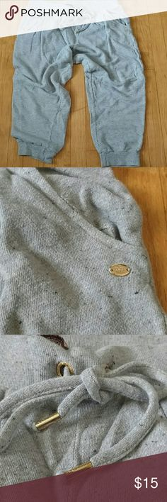 """Juicy Couture Sweat Pants Used But in Good Shape. Grey with black """"confetti"""" all over. Pockets and draw string. Gold details. These are like crop/ capri's. Shows slight wear but lots of life left. Juicy Couture Pants"""